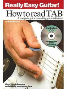 Music Sales America reading  guitar tabs